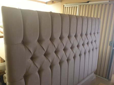 Headboard with deep buttons & channels.